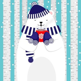 Lindo oso polar sosteniendo una taza de chocolate caliente
