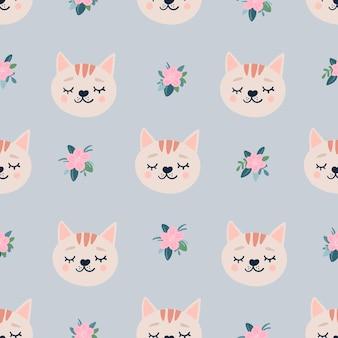 Lindo patrón sin costuras con flores y cabezas de gatos para dormir.
