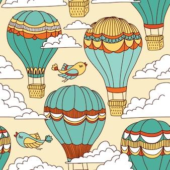 Lindo patrón sin fisuras con globos aerostáticos, pájaros y nubes