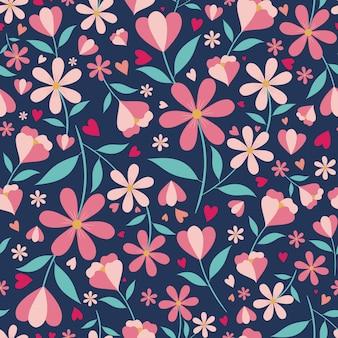 Lindo patrón floral y corazones sin fisuras con fondo azul.