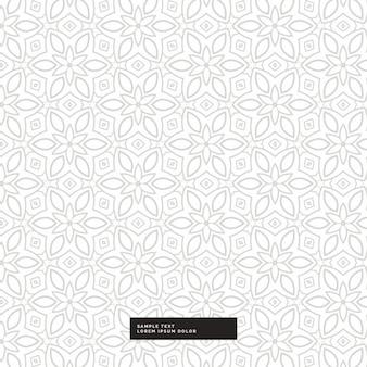 Lindo patrón floral plateado sobre un fondo blanco
