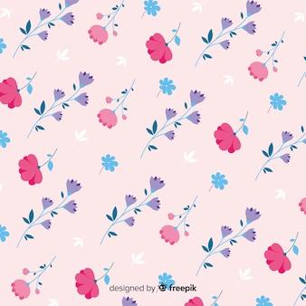 Lindo patrón de flores sobre fondo rosa
