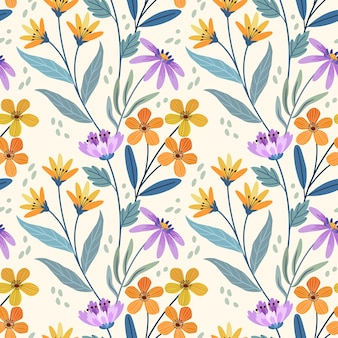 Lindo patrón transparente de pequeñas flores de color amarillo naranja y púrpura.