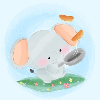 Lindo pequeño elefante cocinando panqueques