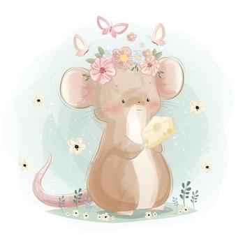 Un lindo ratón sosteniendo un queso