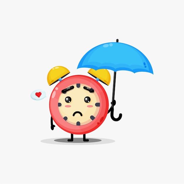 Lindo reloj despertador llevando un paraguas