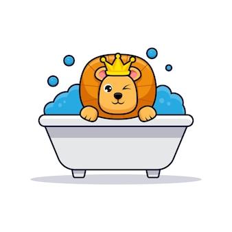 Lindo rey león tomar un baño en la bañera.