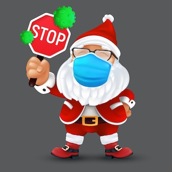 Lindo santa claus vistiendo una mascarilla protectora quirúrgica y sosteniendo una señal de stop con células de virus verdes.