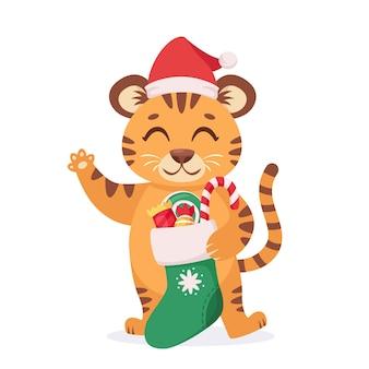 Lindo tigre con calcetín navideño y dulces año del tigre