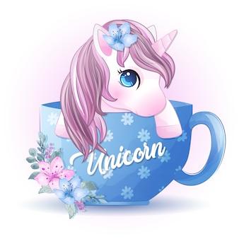 Lindo unicornio dentro de la taza de café