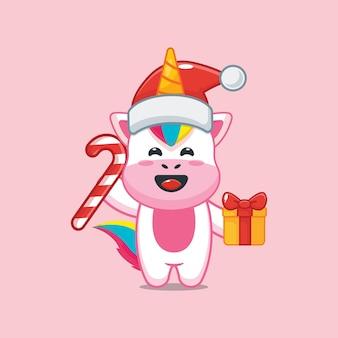 Lindo unicornio en el día de navidad con regalo de navidad y dulces ilustración linda de dibujos animados de navidad