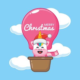 Lindo unicornio en el día de navidad vuela con globo de aire linda ilustración de dibujos animados de navidad