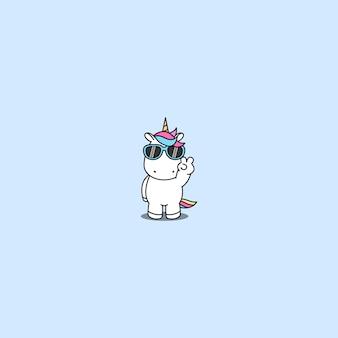 Lindo unicornio con gafas de sol haciendo el signo de la victoria