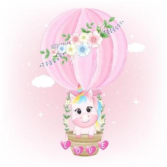 Lindo unicornio en ilustración acuarela de globo de aire caliente
