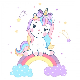 Lindo unicornio mágico sentado en el arco iris.