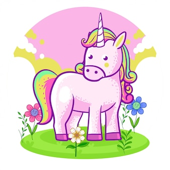 Lindo unicornio de pie en un prado de flores