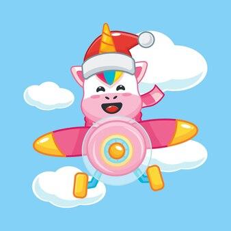 Lindo unicornio con sombrero de santa vuela con avión en el día de navidad linda ilustración de dibujos animados de navidad