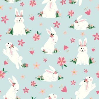 Lindos conejitos con flores de patrones sin fisuras