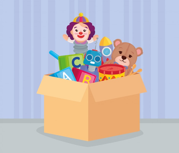 Lindos juguetes para niños en caja de cartón.
