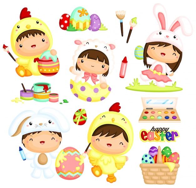 Lindos niños en pascua disfraz pintando huevos