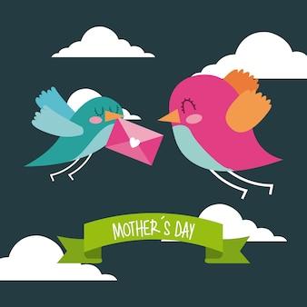 Lindos pájaros volando con sobre en el mensaje del día de las madres del pico