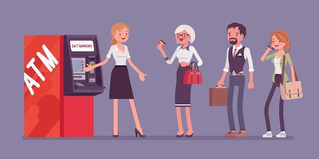 Línea de cajeros automáticos y asistente femenina que ayuda a los clientes