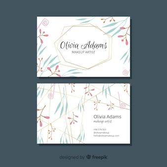 Líneas doradas con concepto de tema floral para tarjeta de visita
