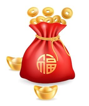 Lingote de oro chino monedas de oro y bolsa roja.