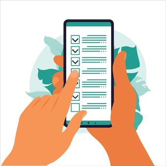 Lista de verificación en la pantalla del teléfono inteligente