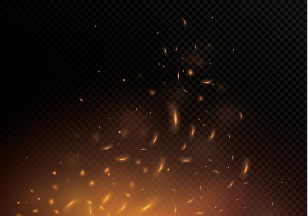 Llama de fuego con chispas sobre un fondo negro