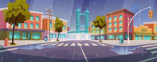 Lluvia en la calle de la ciudad con casas, camino con paso de peatones y semáforos