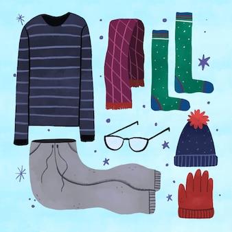 Lo esencial y ropa de invierno dibujada a mano.