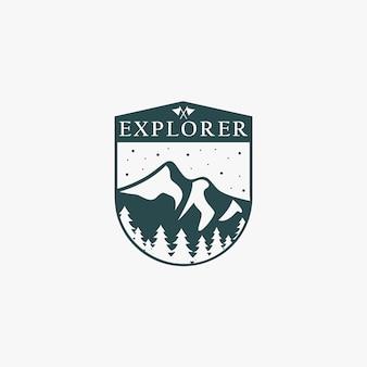 Logo emblema explorer con forma de montaña