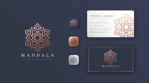 Logo de mandala dorado con tarjeta de visita
