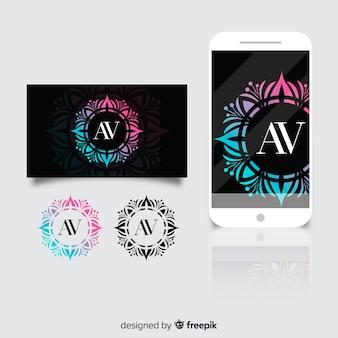 Logo ornamental en tarjeta y teléfono