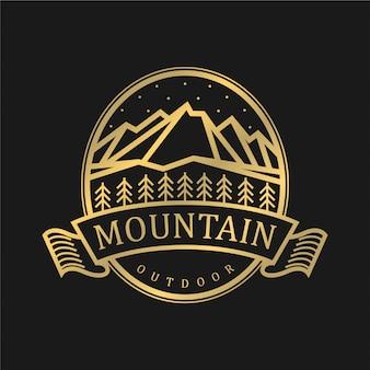 Logo vintage para exterior con elementos de montaña.
