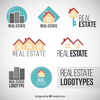 Logos de inmobiliaria planos de colores Vector Premium