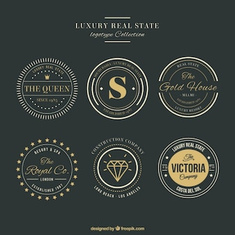 Logos lujosos de inmobiliaria con detalles dorados