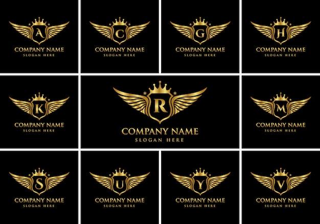 Logotipo de alfabetos de emblema de ala de lujo con cresta logotipo de color dorado