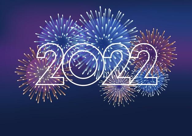 El logotipo del año 2022 y fuegos artificiales con espacio de texto sobre un fondo oscuro celebrando el año nuevo