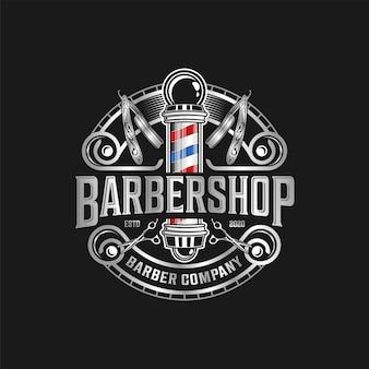 Logotipo de barbería vintage moderno con tijeras y navaja