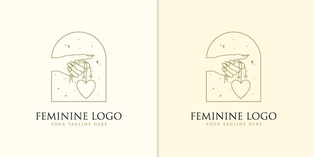 Logotipo de belleza boho con cuentas colgantes de corazón de mano femenina