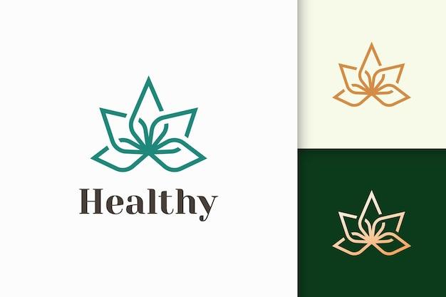 Logotipo de belleza o salud en forma de flor apto para el bienestar o la clínica