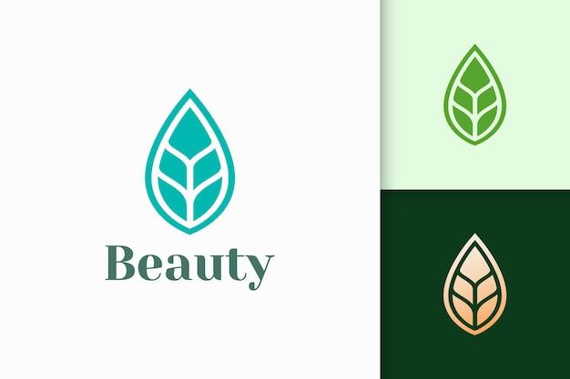 Logotipo de belleza o salud en forma de hoja abstracta y limpia