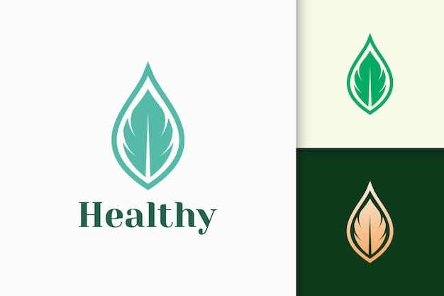 Logotipo de belleza o salud en forma de hoja femenina simple
