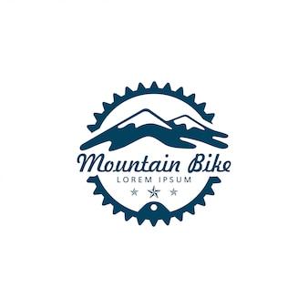 Logotipo de bicicleta de montaña y equipo o anillo de cadena