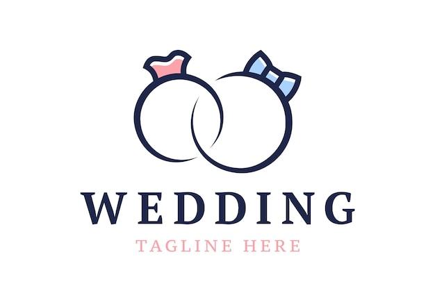 Logotipo de boda. lindos anillos de boda compromiso estilizado.