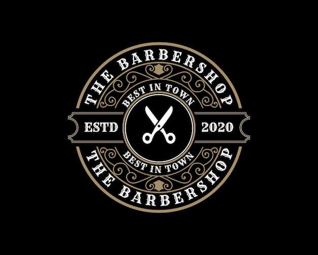 Logotipo caligráfico victoriano de lujo retro antiguo con marco ornamental para peluquería de barbería