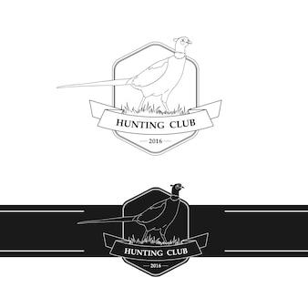Logotipo del club de caza con faisán.