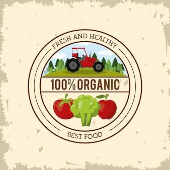 Logotipo colorido con tractor y verduras